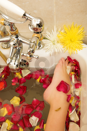 Woman #143 stock photo, Foot of a woman in a bath. by Sean Nel
