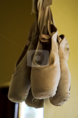 Pointe Shoes #4 stock photo, Pair of Ballet shoes hanging on the wall against a mirror  by Sean Nel