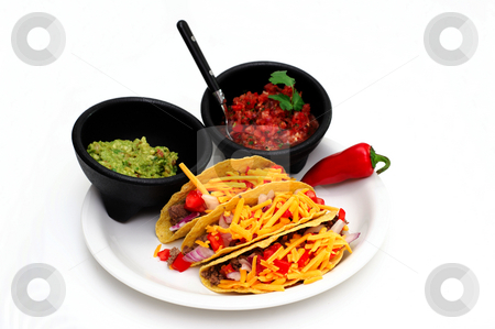 Taco Meal stock photo, Tacos with cheese, ground beef, tomatoes and onions with guacamole and fresh salsa on the side isolated on white by Lynn Bendickson