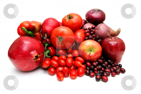 Red Fruit And Vegetables stock photo, Vegetables and fruit all of red coloring including pomegranate, red pears, large and cherry tomatoes, apples, sweet potato, chilie peppers and cranberries. by Lynn Bendickson