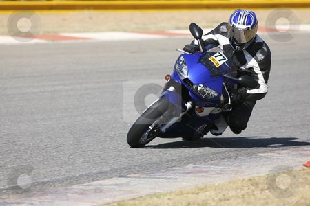 Superbike #54 stock photo, High speed Superbike on the circuit  by Sean Nel