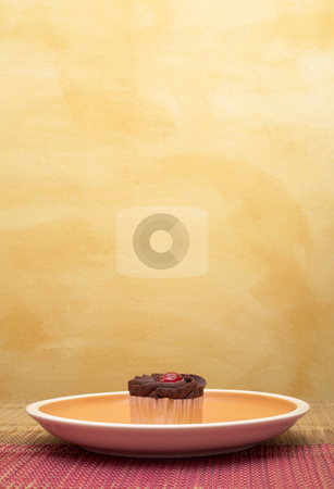 Cupcakes #2 stock photo, Chocolate cupcakes in plate on pink table cloth in front of  wall - copy space by Sean Nel
