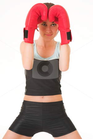 Gym #33 stock photo, A woman in gym clothes, with boxing gloves by Sean Nel