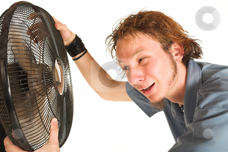 David Badenhorst #9 stock photo, Man with blue shirt cooling down in front of a fan. by Sean Nel