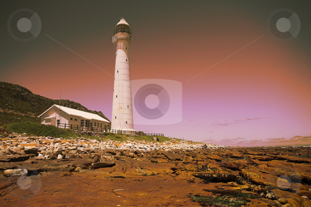 Lighthouse at sunset stock photo, The Slangkop Lighthouse at sunset - Kommetjie, Western Cape. The Tallest Lighthouse in South Africa by Sean Nel
