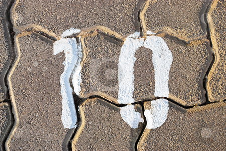 Number 10 stock photo, Number ten paintend on pavement by Sean Nel