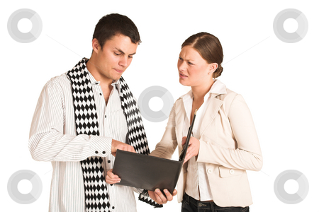 Business People #33(FG) stock photo, Two business partners: one woman and one man.  Looking at a file. by Sean Nel
