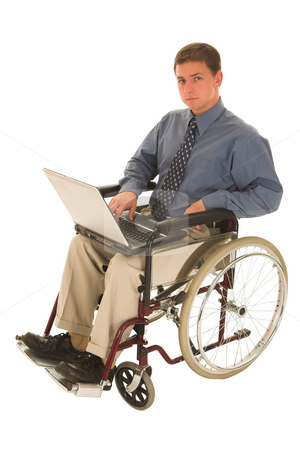 Businessman #140 stock photo, Businessman sitting in a wheelchair working on laptop by Sean Nel