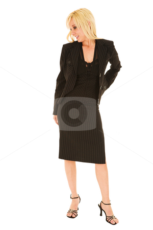 Young blonde businesswoman isolated on white stock photo, Full length image of a young blonde businesswoman in a formal black pinstripe suite with pencil skirt, isolated on a white background by Sean Nel