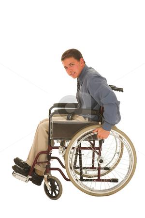 Businessman #123 stock photo, Man sitting in a wheelchair. by Sean Nel