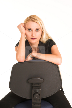 Business Woman #382 stock photo, Blond business woman, dressed in a black clothes. sitting on an office chair. by Sean Nel