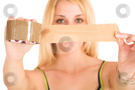 Businesswoman #455 stock photo, Blonde business lady in an informal green top. Holding a piece of tape.  Shallow DOF - hands and tape in focus, face out of focus. by Sean Nel