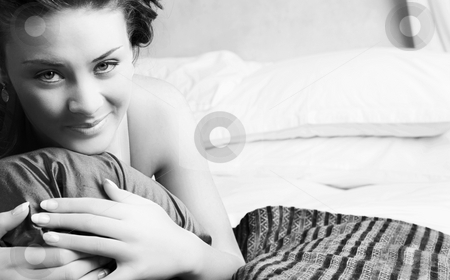 Lingerie#233 stock photo, Woman in underwear on a bed. by Sean Nel
