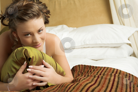 Lingerie#267 stock photo, Woman in underwear lying on a bed. by Sean Nel