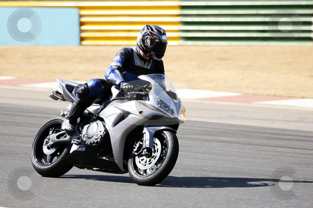 Superbike #80 stock photo, High speed Superbike on the circuit  by Sean Nel