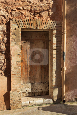Door of a building in Cannes stock photo, Old wooden door of a building in Cannes, France. by Sean Nel