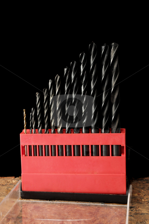 Tools #3 stock photo, Drillbits in red box on brick - black background by Sean Nel