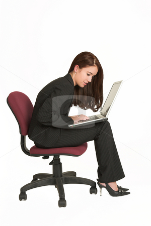 Businesswoman #528 stock photo, Portrait of a brunette business woman, working on a notebook while sitting on an office chair by Sean Nel