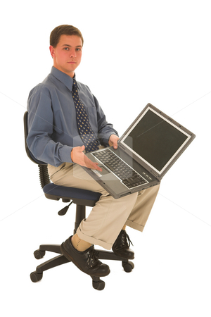 Businessman #60 stock photo, Man sitting on office chair presenting laptop. by Sean Nel