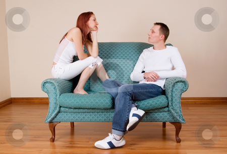 Trudy-Lee & Tommy #2 stock photo, Woman and boyfriend sitting on couch, talking by Sean Nel
