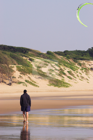 Sudwana #21 stock photo, Man walking on the beach.  Kite flying in the air. by Sean Nel
