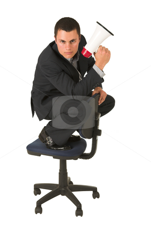 Businessman #248 stock photo, Businessman wearing a suit and a grey shirt.  Making a stunt on an office chair with a megaphone in his hand. by Sean Nel