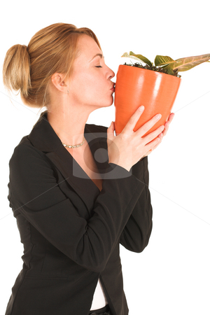 Businesswoman #238 stock photo, Blonde business lady in formal black suit. Holding a potplant. by Sean Nel