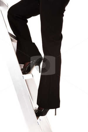 Ladder to success stock photo, Businesswoman in stilettos climbing the ladder to success  by Sean Nel