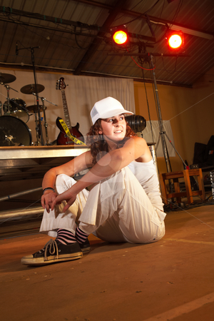 Caucasian freestyle hip-hop dancer stock photo, Single Caucasian freestyle hip-hop dancer at a training session on stage with instruments in the background by Sean Nel