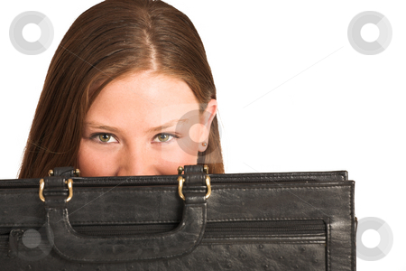 Business Woman #210(GS) stock photo, Business woman hiding behind a black leather suitcase - copy space by Sean Nel