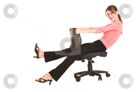 Businesswoman #417 stock photo, Brunette business lady in pink top.  Playing around on office chair - copy space by Sean Nel