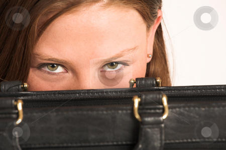 Business Woman #209(GS) stock photo, Business woman hiding behind a black leather suitcase by Sean Nel