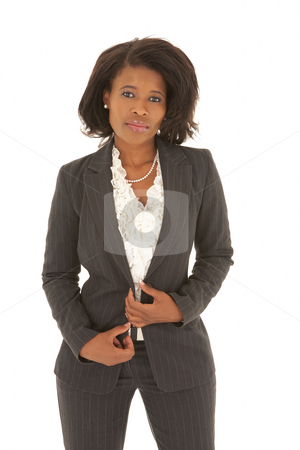 Young adult businesswoman stock photo, Young adult Caucasian businesswoman wearing a grey suit with curly brown hair on a white background. NOT ISOLATED by Sean Nel