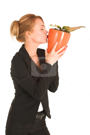 Businesswoman #243 stock photo, Blonde business lady in formal black suit.  Kissing a potplant - eyes closed by Sean Nel