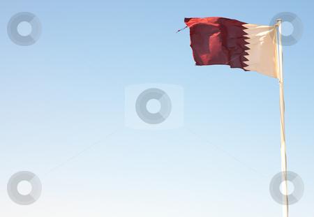 National flag of Qatar stock photo, National flag of Qatar waving against a blue desert sky (movement on edges) by Sean Nel