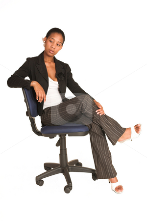 Mida Matsimela #22 stock photo, African business woman dressed in black jacket.  Sitting on office chair by Sean Nel