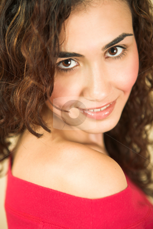 Young adult woman stock photo, Portrait of a beautiful young adult Caucasian woman with light skin and curly brown hair, brown eyes and pink lips, wearing a red top. Very Shallow Depth of Field by Sean Nel