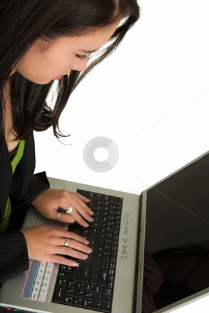 Business Woman # 516 stock photo, Businesswoman working on  a notebook, looking down.  Shallow D.O.F  by Sean Nel