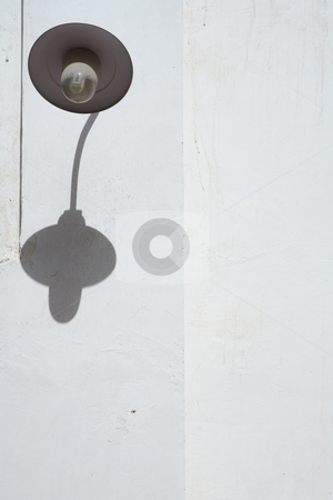 Lamp stock photo, Dusty outdoor lamp on a white wall by Sean Nel