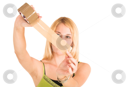 Businesswoman #454 stock photo, Blonde business lady in an informal green top. Holding a piece of tape.  Shallow DOF, hands and tape in focus, face out of focus.  Copy space. by Sean Nel