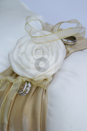 Ring cushion stock photo, White and brown ring cushion by Sean Nel
