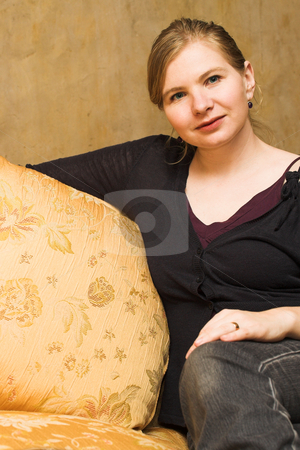 Woman #22 stock photo, Adult woman sitting comfortably on a luxurious couch by Sean Nel