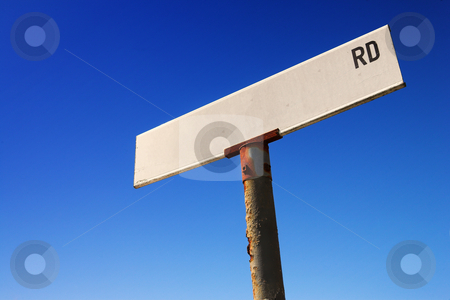 Sign against blue sky stock photo, Weathered old road sign against a clear blue sky - Space for text by Sean Nel