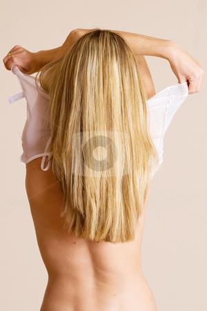 Woman #11 stock photo, Beatiful blonde woman undressing by Sean Nel