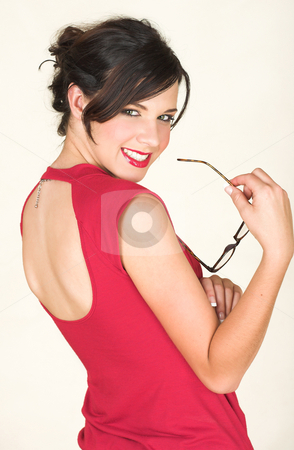 Young caucasian businesswoman stock photo, Young adult brunette businesswoman with horn rimmed glasses and a red dress. She is Caucasian and wears bright red lipstick. White background, not Isolated by Sean Nel