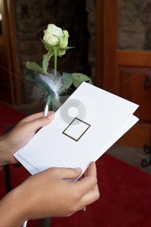 Invitations #3 stock photo, Lady holding white invitation by Sean Nel