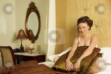 Lingerie#240 stock photo, Woman in underwear sitting on a bed. by Sean Nel