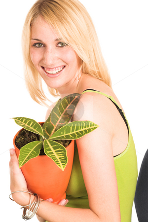 Businesswoman #461 stock photo, Blonde business lady in an informal green top. Holding a pot plant, lauching. by Sean Nel