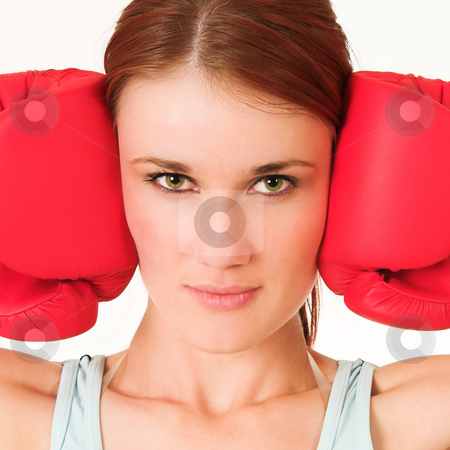 Gym #26 stock photo, A woman in gym clothes, wearing red boxing gloves. by Sean Nel