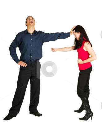 Businessman fighting with businesswoman on white background stock photo, Businessman holding a female coworker away who is trying to hit him while laughing manically. The couple is isolated on white. Image can be used for office politics or keeping woman out of management areas or rising in the workplace. by Sean Nel